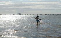 Little boy paddling in the sea. Weston Super Mare, Somerset. - John Harris - 2000s,2005,appealing,beach,BEACHES,boy,boys,charming,child,CHILDHOOD,children,COAST,coastal,coasts,cute,day out,emilio,holiday,holiday maker,holiday makers,holidaymaker,holidaymakers,holidays,juvenile