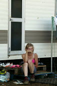 Polish migrant worker takes a break from picking strawberries in Bretforton. Fusion Personnel. Sitting on her caravan doorstep. - John Harris - 06-09-2005