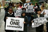 Children from the community march for peace on the Lozells Road Birmingham, united in grief. They marched through the rain to the spot where Mr Young-Sam was stabbed by a gang of up to 11 men during S... - John Harris - 2000s,2005,activist,activists,asian,bigotry,Birmingham,black,BME Black minority ethnic,CAMPAIGN,campaigner,campaigners,CAMPAIGNING,CAMPAIGNS,child,CHILDHOOD,children,cities,city,CLJ,communities,commun