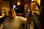 Pub landlord calling time as the licensing laws are reformed. - John Harris - 2000s,2005,alcohol,bell,bells,drink,drinker,drinkers,drinking,drinks,EBF Economy,farm,farmed,farming,farms,hour,hours,last,Night Shift,orders,PEOPLE,producer,Public House,ring,ringing,rings,Social Iss