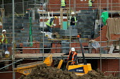 Construction of new houses. Warwickshire - John Harris - 2000s,2006,bricklayer,bricklayers,bricklaying,builder,builders,building site,Construction Industry,EBF Economy,greenfield,house,house building,housebuilder,housebuilders,housebuilding,houses,job,jobs,