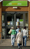 Young women going into a Jobcentre Plus. - John Harris - ,2000s,2006,a,adolescence,adolescent,adolescents,agency,benefit,benefits,BENIFIT,BENIFITS,centre,centres,claim,claimant,claimants,claiming,dole,employment,FEMALE,interacting,interaction,job,job center