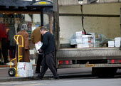 Driver delivering goods to a shop in the High Street. - John Harris - 2000s,2006,deliveries,delivering,delivery,driver,drivers,DRIVING,EBF Economy,goods,HAULAGE,HAULIER,HAULIERS,HGV,hgvs,highway,job,jobs,LAB LBR Work,LGV,LGVs,lift,lifting,load,loading,lorries,lorry,manu