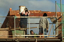 Laying bricks Construction of new buildings. Stratford on Avon, Warwickshire - John Harris - 2000s,2006,balance,BRICK,bricklayer,bricklayers,bricklaying,bricks,builder,builders,building site,Construction Industry,EBF Economy,heavy,job,jobs,LAB LBR Work,Laying,lift,lifting,newbuild,people,Warw