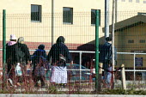 Relatives visiting Harmondsworth Immigration Removal Centre - John Harris - 2000s,2006,Asylum Seeker,Asylum Seeker,BME Black minority ethnic,center,centre,cities,city,CLJ,deportation,deportations,deporting,detained,detainee,detainees,detention,Diaspora,displaced,foreign,forei