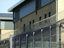 Harmondsworth Immigration Removal Centre - John Harris - ,2000s,2006,Asylum Seeker,Asylum Seeker,Barbed Wire,center,centre,cities,city,CLJ,deportation,deportations,deporting,detained,detainee,detainees,detention,Diaspora,displaced,fence,foreign,foreigner,fo