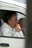 Builder eating his lunch of a Cornish pasty in the van, Cornwall - John Harris - 2000s,2006,break,builder,builders,Construction Industry,diet,diets,dinner,dinners,DINNERTIME,eat,eating,EBF Economy,fast food,fast food,fastfood,food,FOODS,job,jobs,LAB LBR Work,lunch,LUNCH BREAK,LUNC