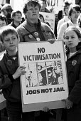 Miner's wife and children, rally against the victimisation of miners. Sheffield - John Harris - 30-03-1985