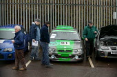 The ignominious end for MG Rover. Viewers at the auction of MG Racing cars at Longbridge, Birmingham. - John Harris - 24-03-2006