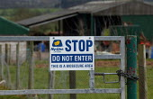 Do not enter, This is a Biosecure Area sign on a free range chicken farms gate in Warwickshire. Biosecurity measures to protect against infection - John Harris - 2000s,2006,against,agricultural,agriculture,animal,animals,avian,bio,bird,birds,capitalism,capitalist,chicken,chickens,communicating,communication,concerns,control,country,countryside,disease,DISEASES