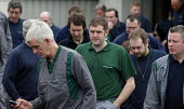 Grim faces as workers leaving a meeting at the PSA Peugeot Citroen plant. The French carmaker is to close the factory with the loss of 2,300 jobs. Ryton near Coventry - John Harris - 19-04-2006