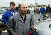 Grim faces as workers arrive for a meeting at the PSA Peugeot Citroen plant. The French carmaker is to close the factory with the loss of 2,300 jobs. Ryton near Coventry - John Harris - 2000s,2006,auto industry,Automotive,capitalism,capitalist,Car Industry,carindustry,CLOSED,closing,closure,closures,deindustrialisation,Deindustrialization,EBF Economy,FACTORIES,factory,French,industri