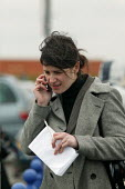 PA Journalist on mobile phone. PSA Peugeot Citroen plant. Media interviewing a worker. The French carmaker is to close the factory with the loss of 2,300 jobs. Ryton near Coventry - John Harris - 2000s,2006,association,ASSOCIATIONS,auto industry,Automotive,call,calls,capitalism,capitalist,Car Industry,carindustry,CLOSED,closing,closure,closures,communicating,communication,FACTORIES,factory,FEM
