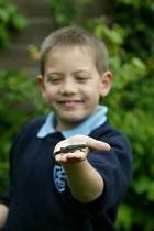Boys catching newts from the garden pond. - John Harris - 2000s,2006,amphibian,amphibians,animal,animals,boy,boys,catch,catching,child,CHILDHOOD,children,common,edu education,eni environmental issues,garden,GARDENS,having fun,juvenile,juveniles,kid,kids,male