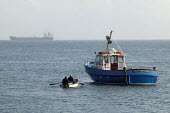 Pilot and crew rowing out to their passenger ferry to Skolmer Island, Pembrokeshire - John Harris - 11-06-2006