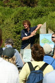 Guide briefing visitors who have come to watch sea birds Skomer Island, South West Wales - John Harris - 11-06-2006