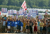 """Hundreds of young Polish migrant workers waving a Solidarnosc flag protesting at their working conditions in a """"Stop exploitation picket"""" at S and A Produce, Strawberry farm which supplies a third of... - John Harris - 2000s,2006,activist,activists,agriculture agricultural,bme minority ethnic,campaign,campaigner,campaigners,CAMPAIGNING,CAMPAIGNS,DEMONSTRATING,DEMONSTRATION,DEMONSTRATIONS,Diaspora,DISPUTE,DISPUTES,EA"""