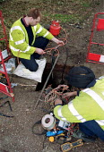 BT engineers maintaining cabling on the roadside - John Harris - 16-03-2000