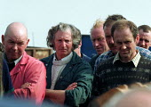 Farmers buying farm machinery and tools at an auction of goods of a farmer who has gone out of business. Warwickshire. 22,000 Farmers and Agricultural workers quit farming in year to June 1999. - John Harris - 22-03-2000