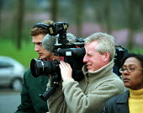 TV camera, sound technician and journalist filming, Rover Longbridge Birmingham - John Harris - 16-03-2000