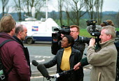 TV camera, sound technician and journalist filming an interview with a Rover worker Longbridge Birmingham - John Harris - 16-03-2000