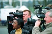 TV camera, sound technician and journalist filming. Rover Longbridge Birmingham - John Harris - 16-03-2000