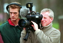 TV camera, sound technician filming. Rover Longbridge Birmingham - John Harris - 16-03-2000