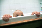 Baby boy in the bath at 9 months - John Harris - 2000,2000s,appealing,babies,baby,bath time,boy,boys,CARE,carer,carers,charming,child,Child Care,childcare,CHILDHOOD,CHILDMINDING,children,cute,EARLY YEARS,Emilio,families,family,infancy,infant,infants