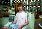 Young worker packing books, production line at OUP automated print distribution centre Corby - John Harris - 1990s,1999,automated,AUTOMATIC,AUTOMATION,BOOK,books,capitalism,capitalist,distribution,EBF economy business,EMOTION,EMOTIONAL,EMOTIONS,employee,employees,Employment,europeregi,HAPPINESS,happy,Industr