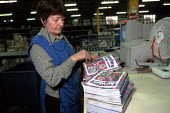 Older women worker packing magazines on a production line at OUP automated print distribution centre Corby - John Harris - 1990s,1999,attention,attentive,automated,AUTOMATIC,AUTOMATION,capitalism,capitalist,distribution,EARNINGS,EBF economy business,engaged,EQUALITY,fan,female,Income,INCOMES,Industries,industry,inequality