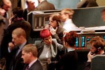 Women trader at London Metal Exchange in the City of London. - John Harris - 03-05-2000