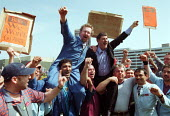 Dr Carl Chinn and Rover workers celebrating the completion of the deal for Phoenix to buy Longbridge Rover from BMW outside the plant. - John Harris - 09-05-2000