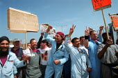 Rover workers celebrating the completion of the deal for Phoenix to buy Longbridge Rover from BMW outside the plant. - John Harris - 09-05-2000