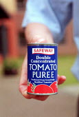 A tin of genetically modified tomato puree from Safeway which was withdrawn due to the public reaction to the possible environmental effects of contamination to non gmo. - John Harris - ,2000,2000s,EBF Economy,ENI environmental issues,ENVIRONMENT,environmental,food,foods,genetic,genetic modification,genetically modified,genetics,gm,gmo,public,Safeway,SCT technology