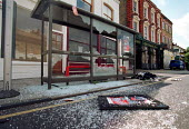 Morning after the night before: Vandalised bus stop by a pub. Dalston London. - John Harris - 31-05-2000