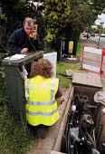 BT engineers replacing a PCP cabinet box, checking telephone line. - John Harris - 07-06-2000