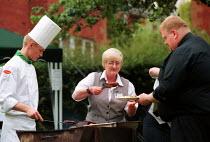 Part time women catering worker serving food. - John Harris - 07-07-2000