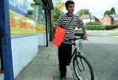 Paperboy on his delivery round with his bag of newspapers and bicycle. - John Harris - 16-08-2000