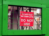 A building site Health and safety notice warning of the danger of incomplete scaffold. Construction site Worcester. - John Harris - 2000,2000s,building,BUILDINGS,Construction Industry,EBF economy business,Health AND safety,job,jobs,lab lbr work,people,scaffolding,worker,workers,working