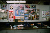 Work bench in engineering dept. with motorcycle and pornography pin ups. - John Harris - 16-01-2001
