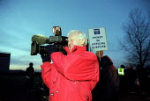 TV camera crew filming Rolls-Royce workers picketing during a one day strike against redundancies and job losses. It is the first strike for 20 years by MSF and GMB trades union members. Ansty Coventr... - John Harris - 2000s,2001,against,broadcast,broadcasting,camera,camera media,Cameraman,cameras,crew,dispute,DISPUTES,film,filming,industrial dispute,job,job cuts,job loss,jobs,lbr work,losses,member,member members,m