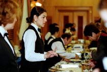 Hotel catering workers serving food. - John Harris - 09-03-2001