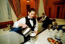 Hotel catering workers serving coffee. - John Harris - 09-03-2001