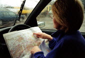 Maff Animal Health Officer in her car, looking on an Ordnance Survey Map to locate a farm to carry out an inspection, checking for symptoms of foot and mouth disease in an at risk area. - John Harris - 28-03-2001