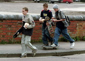 Teenagers with skateboards and fast food. - John Harris - 2000s,2001,adolescence,adolescent,adolescents,away,aways,beef burger,beef burgers,beefburger,BEEFBURGERS,boy,boys,child,CHILDHOOD,children,chip,chips,eating,EXTREME,fashion,fast food,fast food,fastfoo