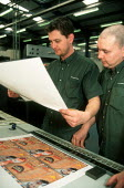 Printers checking print quality at printing factory. - John Harris - 2000s,2001,capitalism,capitalist,checking,EBF economy business,Industries,industry,job,jobs,LAB LBR work,maker,makers,making,manufacture,manufacturer,manufacturers,Manufacturing,people,print,Print Wor