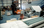 Printer checking print quality at printing factory. - John Harris - 2000s,2001,capitalism,capitalist,checking,driver,drivers,driving,EBF economy business,fork,Fork lift,forklift,Forklift Truck,forklift trucks,forklifts,Industries,industry,job,jobs,LAB LBR work,lift,ma