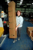 Woman printer moving cardboard boxes at printing factory. - John Harris - 2000s,2001,age,ageing population,box,boxes,capitalism,capitalist,EBF economy,elderly,female,Industries,industry,job,jobs,LAB LBR work,maker,makers,making,manufacture,manufacturer,manufacturers,Manufac