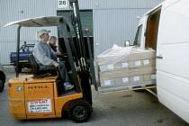 Loading a van by fork lift truck at printing factory. - John Harris - 2000s,2001,capitalism,capitalist,driver,drivers,driving,EBF economy,FORK,Fork lift,forklift,Forklift Truck,forklift trucks,forklifts,Industries,industry,job,jobs,LAB LBR work,LIFT,load,Loading,maker,m