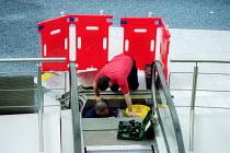 Engineering contractors maintaining an escalator. - John Harris - 12-04-2001